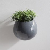 Petite yet stylish, these wall-mountable ceramic planters add visual appeal on blank walls. Create a living work of art by filling them with dried or silk flowers, even a small potted plant. Wall vases are available in 3 colors. $32