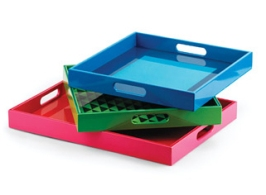 "These trays are yelling ""Let's part-aayy"" colors. High gloss and vibrant, they square away drinks and snacks all the while being the talk of the party. Choose from solid colors or pattern play. $29"